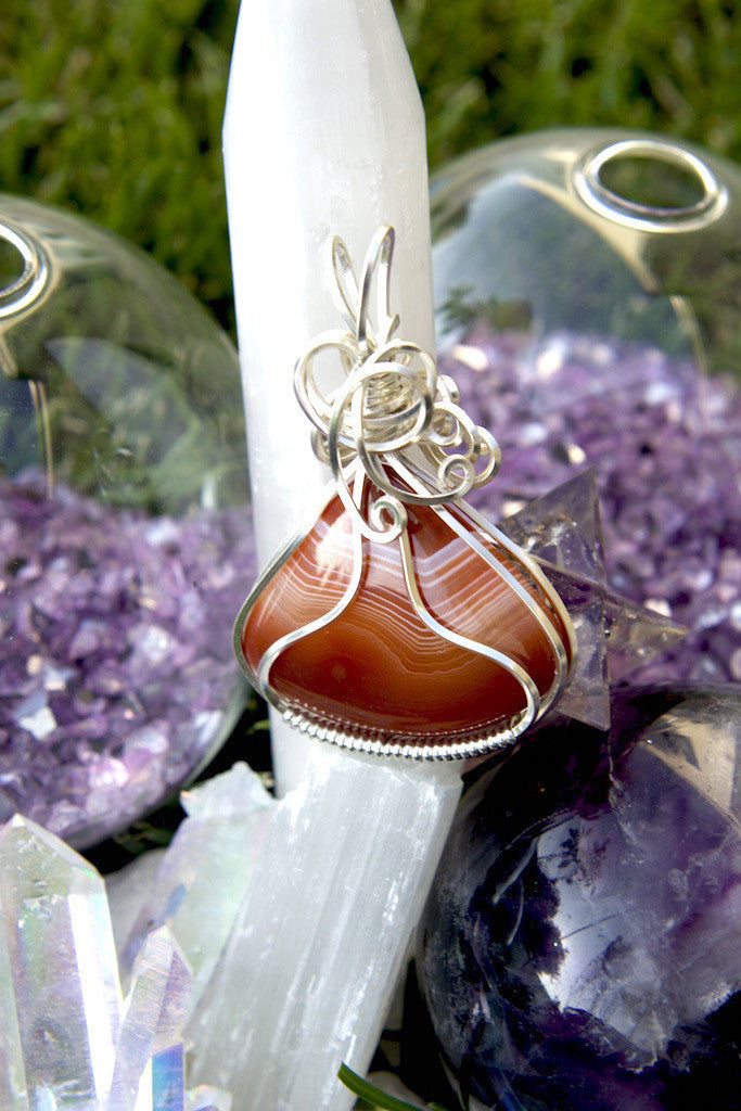 Courage: a red banded agate pendant