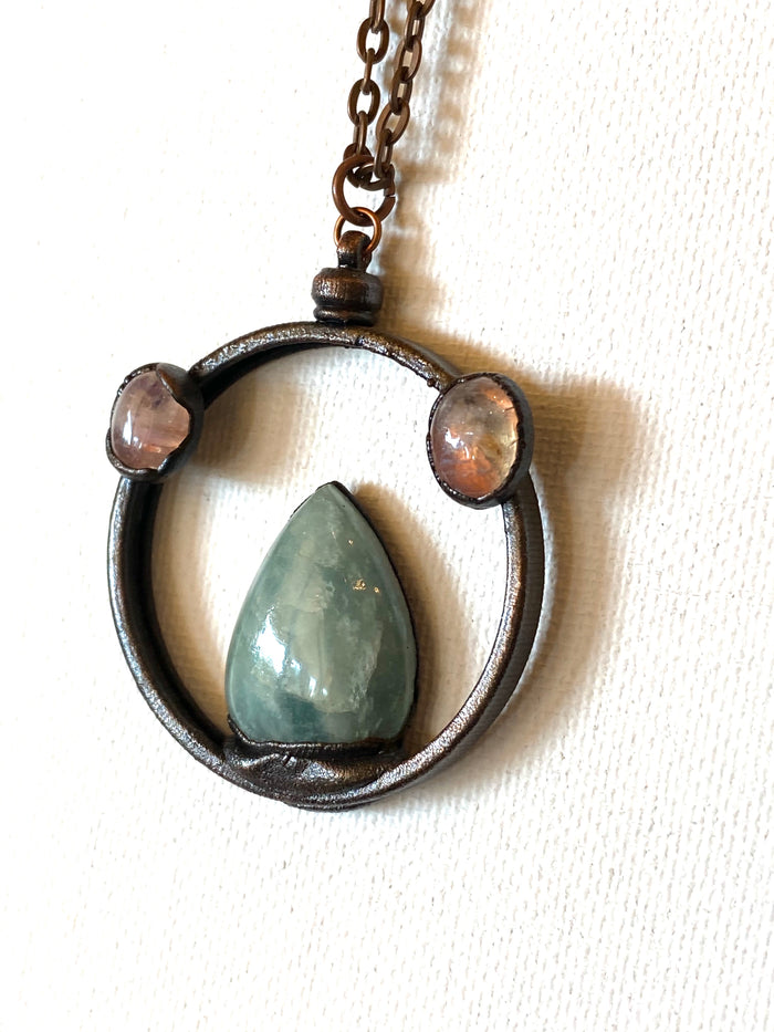 Adventuring and Moonstone pendant