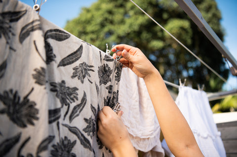 Hanging up washing with stainless steel pegs