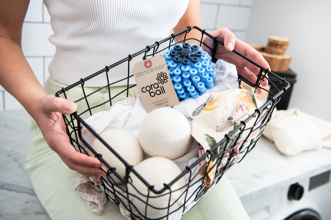 Laundry basket with cora ball, dryer balls, pegs and clothes