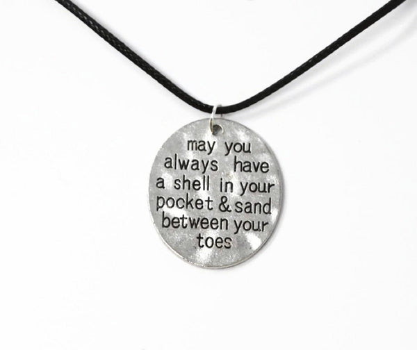 "Beach Necklace ""May You Always Have A Shell In Your Pocket & Sand Between Your Toes"" Stamped Pendant. Adjustable Black Cotton Cord."