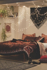 A Boho and eclectic look with macrame and tapestries setting