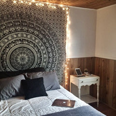 Romantic Spark with Garland Lights bordering a tapestry on a bedroom - Beautiful decor