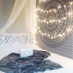 Romantic Spark with Garland Lights across a tapestry on a bedroom - Beautiful decor