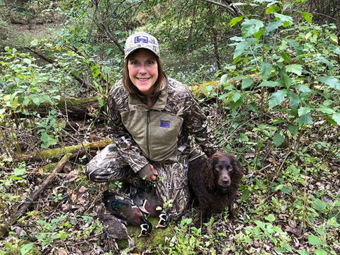 Brenda Maier with dog and pheasants