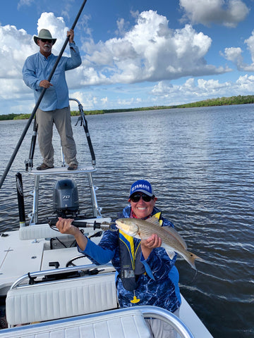 Mission accomplished! Captain John Hand puts Angie on her 1st ever snook!