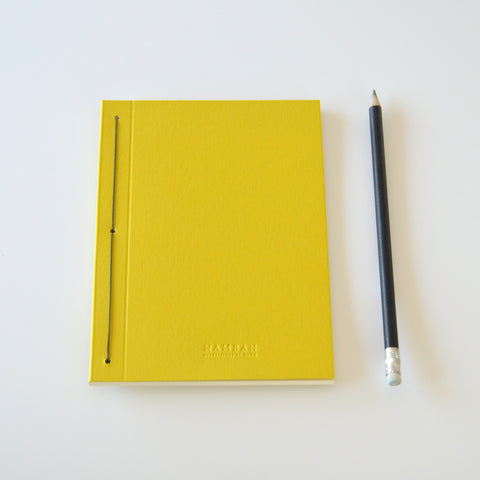 Thin yellow notebook