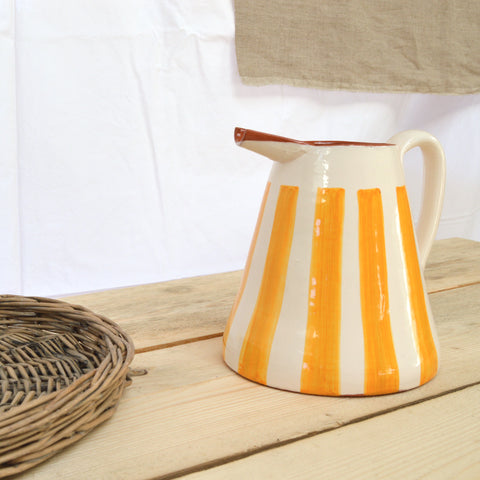 terracotta striped jug yellow