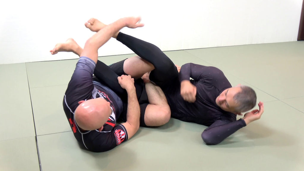 Backstep to Outside Heel Hook and Knee Bar with Joel Bouhey