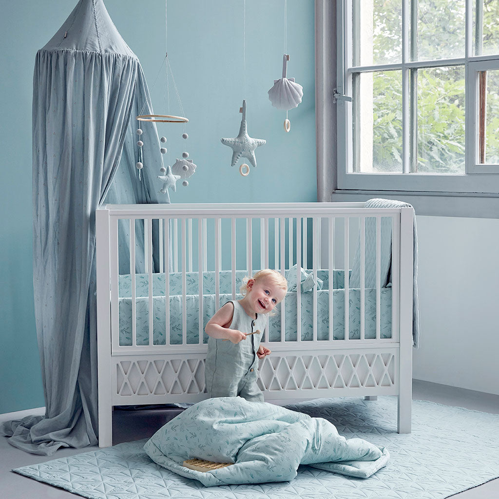 Cam Cam Copenhagen Harlequin Baby Bed White - Lifestyle - The Baby Service