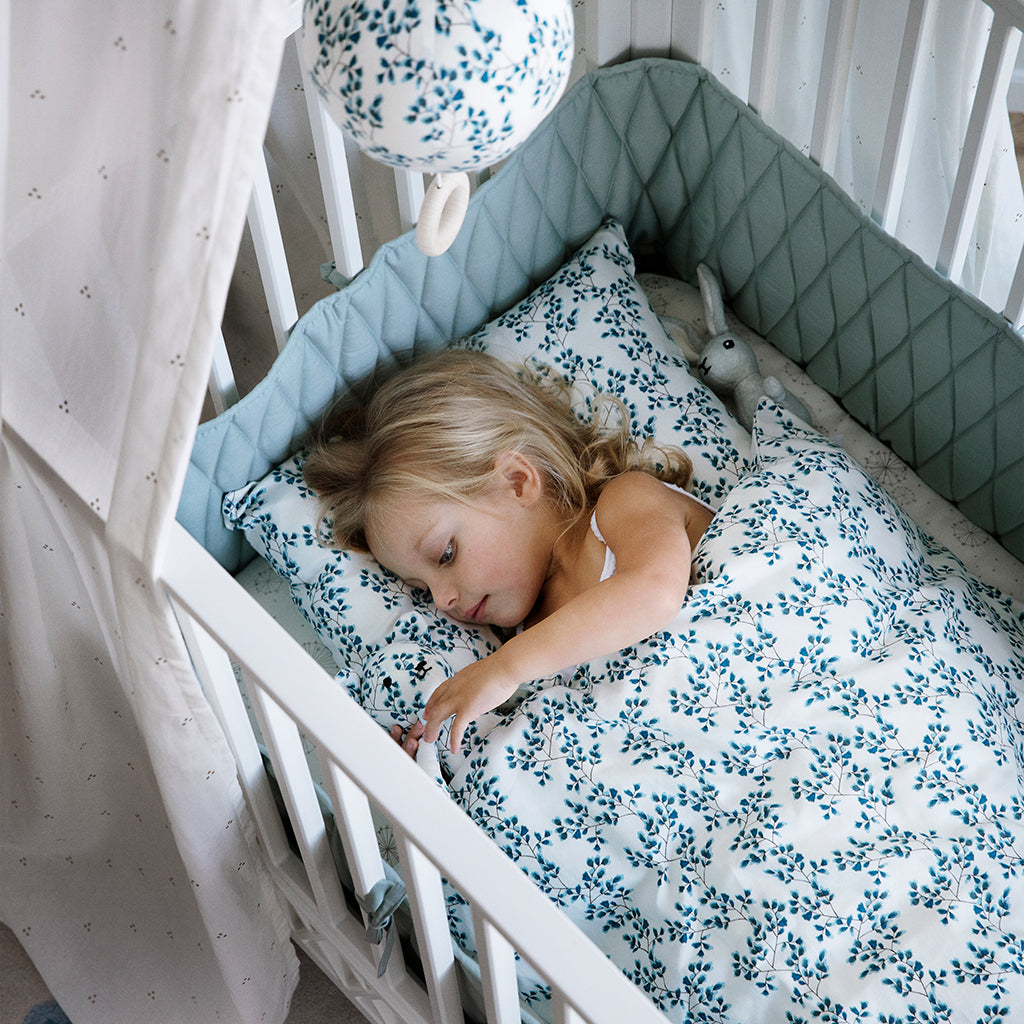 Cam Cam Copenhagen Harlequin Baby Bed White - Close Up - The Baby Service
