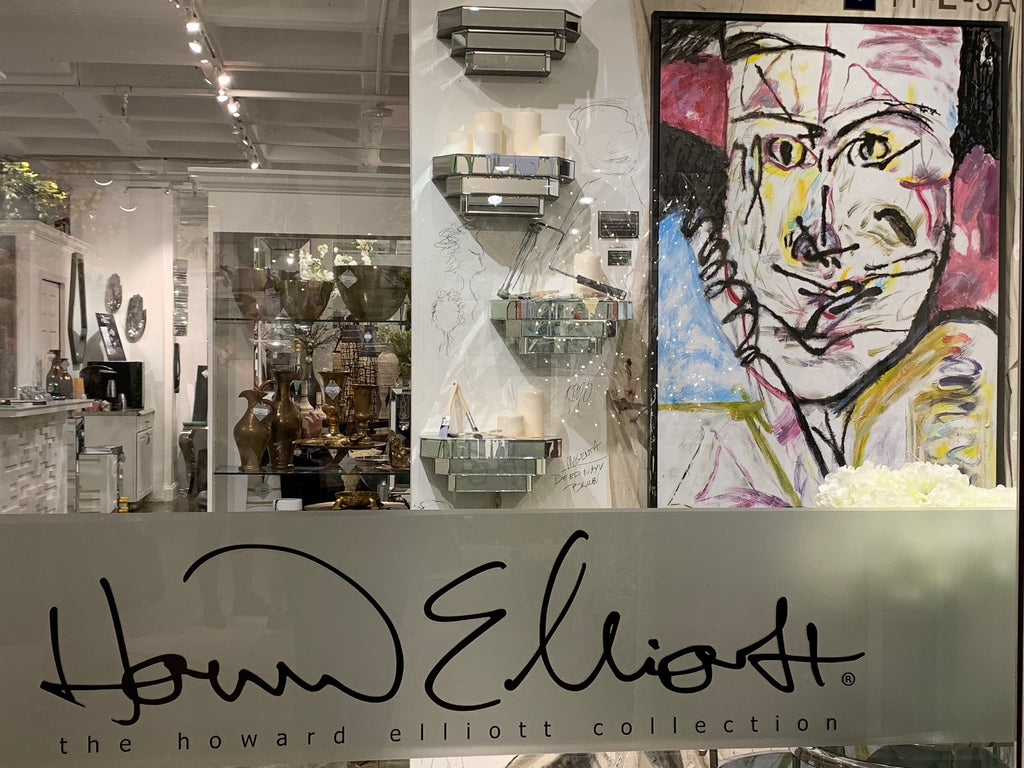 Self-portrait of Jody Ossman at the entryway to Howard Elliott