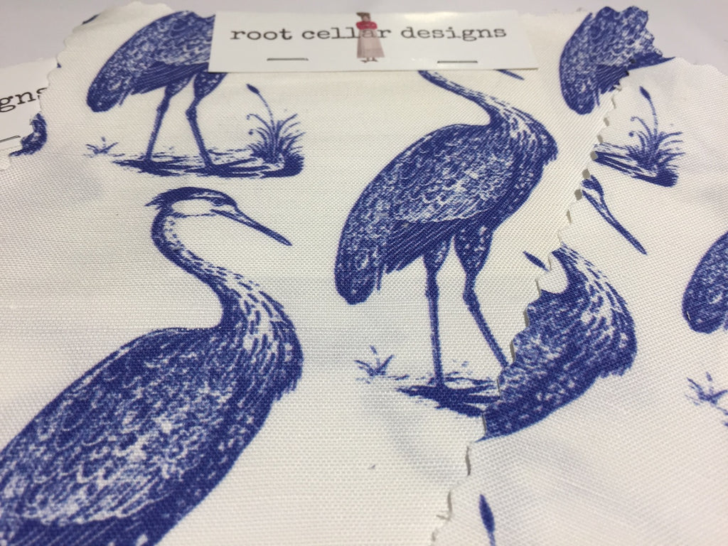 Root Cellar Designs Blue Heron Pattern in white and marine at Dallas Market