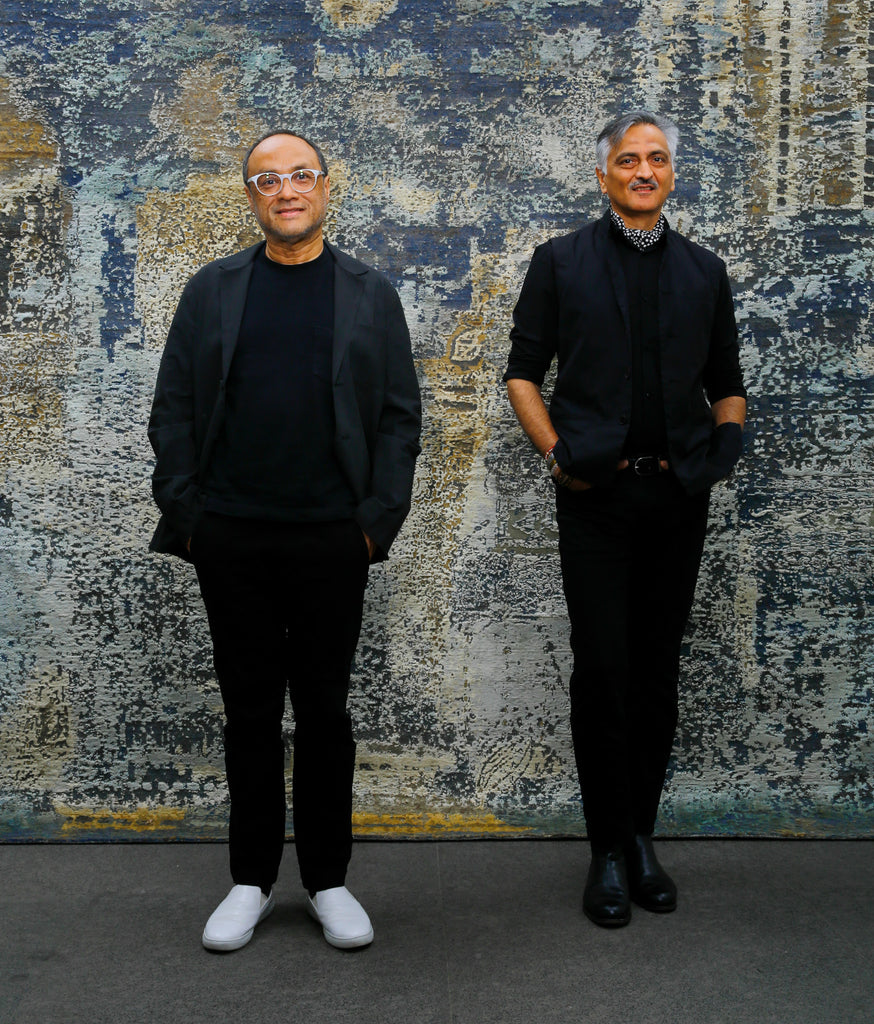 David Abraham and Rakesh Thakore in front of the Sanganer carpet, now available at ABC Carpet & Home.