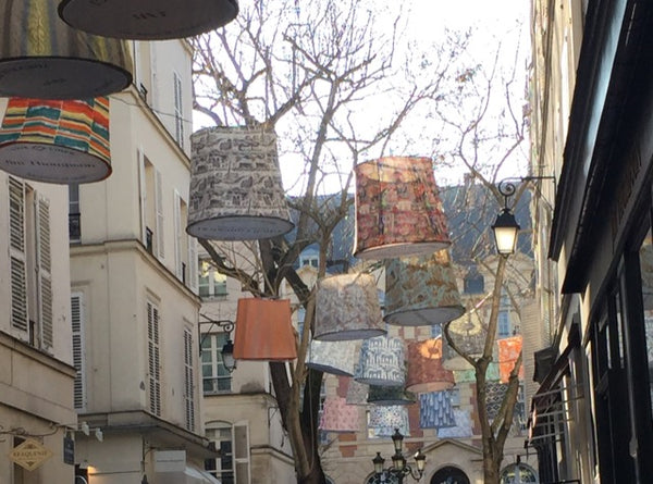 Fabric lanterns sway across the narrow streets of the Left Bank for Deco Off in Paris.
