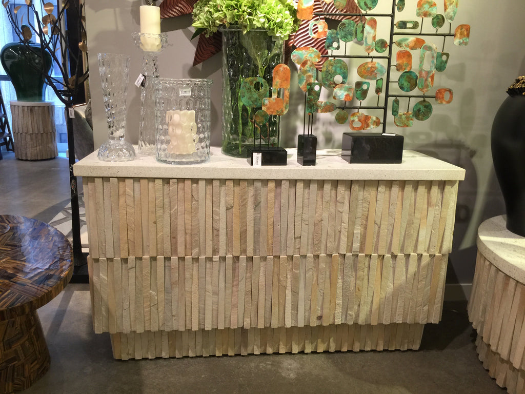 Global Views brought the Teeter Totter console table to their showroom in AmericasMart