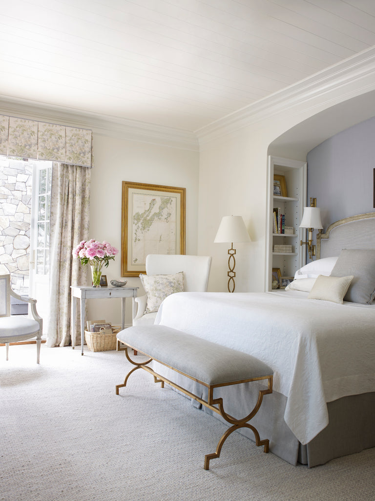 A master bedroom in a home in Port Clyde, Maine, designed by Suzanne Kasler