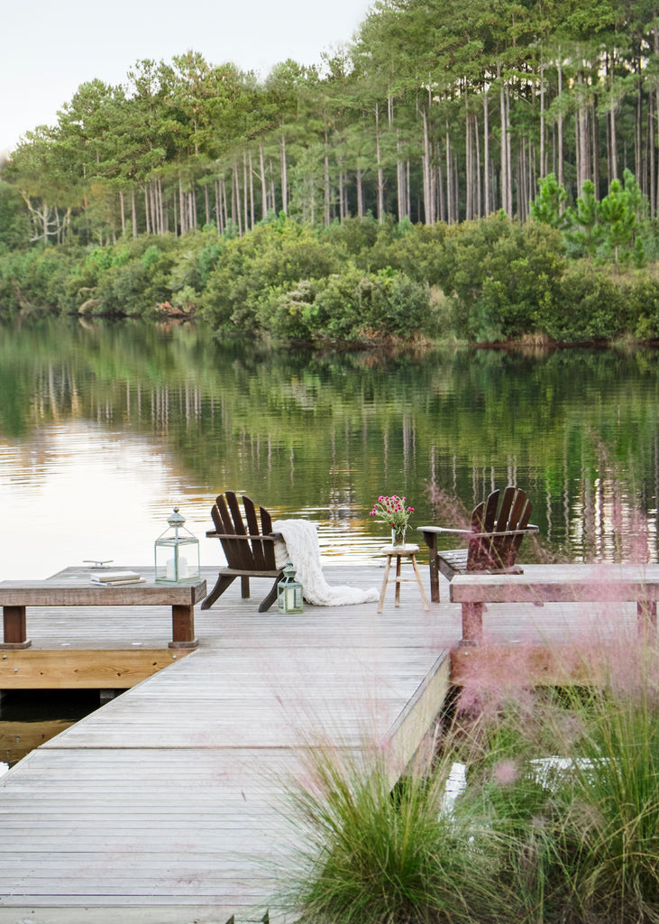 A dock in Palmetto Bluff styled by Suzanne Kasler
