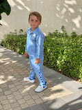 Kids Baby blue tracksuit in lightweight fabric. Pants with popper effect for on trend street style