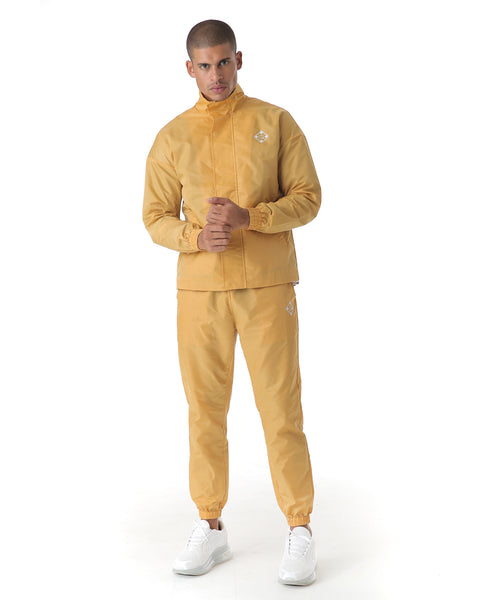 Mustard tracksuit in a lightweight fabric. Cuffed sleeves & pants