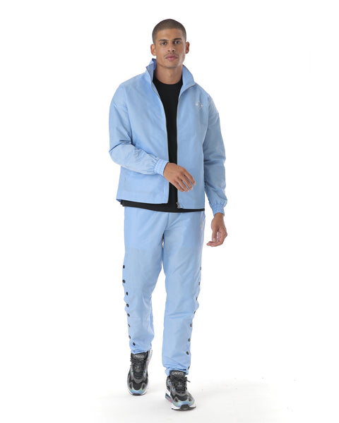 blue tracksuit in a lightweight fabric. Pants with popper effect for on trend street style