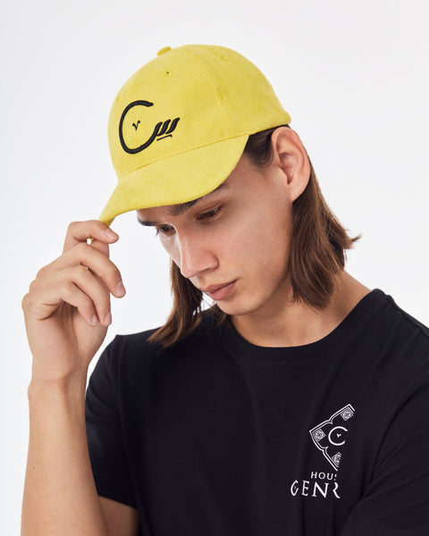Tie back hat with House of Cenmar logo. Double yellow with black