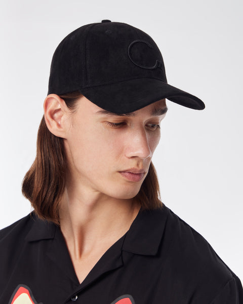 Triple black House of Cenmar tie back hat