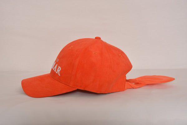 Tie back hat with House of Cenmar. Double Orange with white