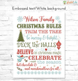 Christmas Rules Family Name Sign embossed text on white background
