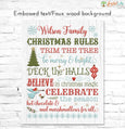 Christmas Rules Family Name Sign embossed text on faux white wood background