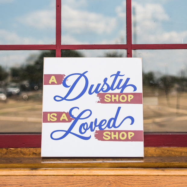 Dusty Shop Sign