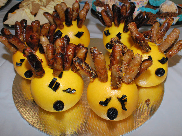 sausage hedgehog - party food - liquorice eye lashes - kids party food