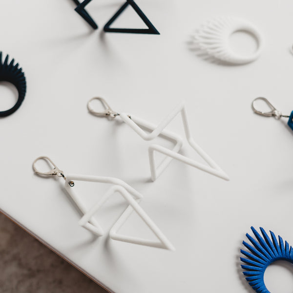 White Geometric Infinity Earrings - Earrings - Iris Van Hulst - Jewellery - Arlette Gold