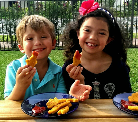 Kids eating ketchup