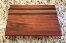 "Vibrant ""Racetrack"" Padauk Cutting Board"