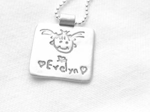 medium personalized silver tags with a signature or a drawing