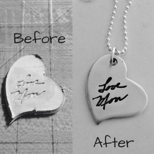 small personalized silver tags with a signature or a drawing