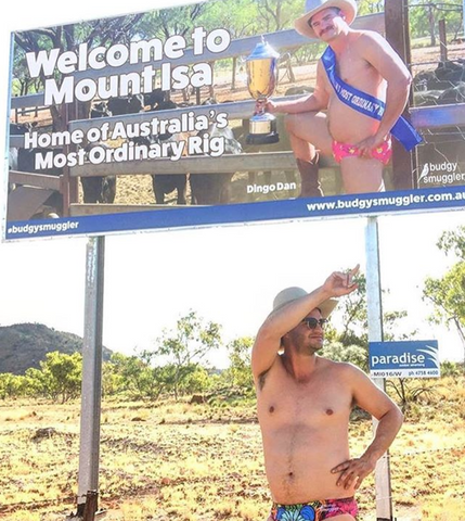 Dingo Dan in front of his Mount Isa Billboard in Queensland Australia