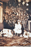 Early Photograph of Child on Christmas Morning by a Christmas Tree