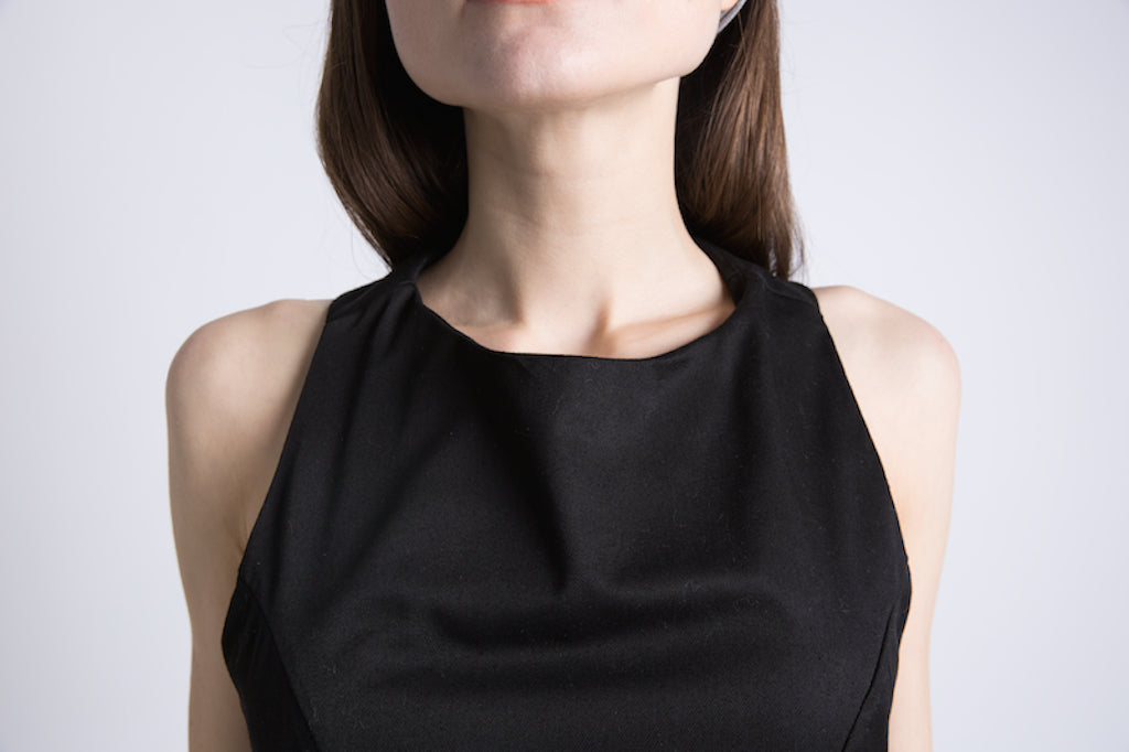 Close-up of Casa Como black sleeveless mini dress with racer back.