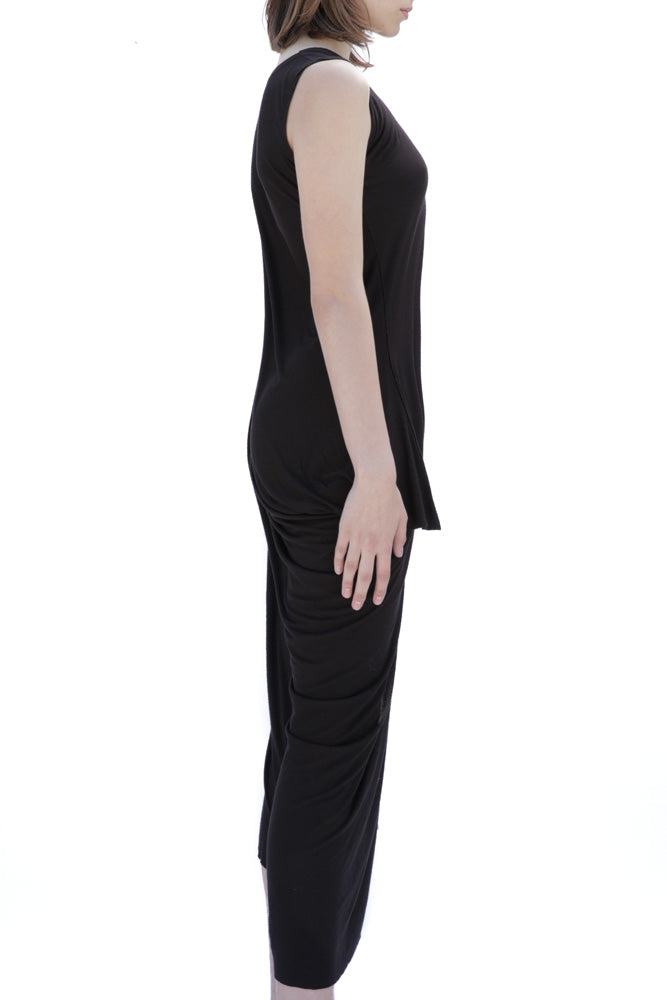 Case Como black sleeveless dress with draped asymmetric hem.