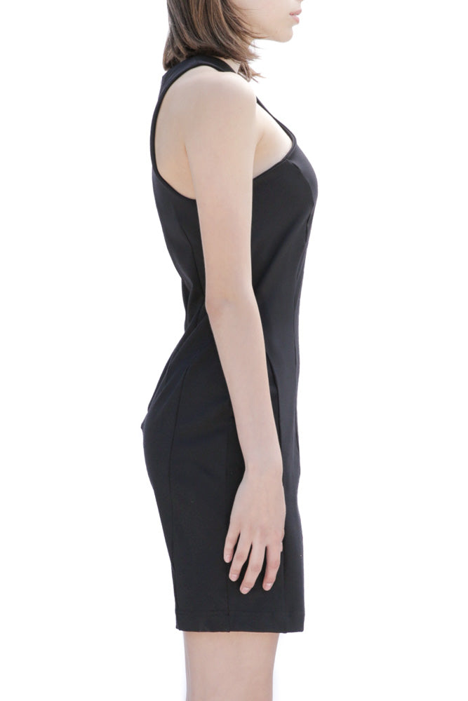 Side of Casa como fitted black dress with curved collar and exposed zipper.