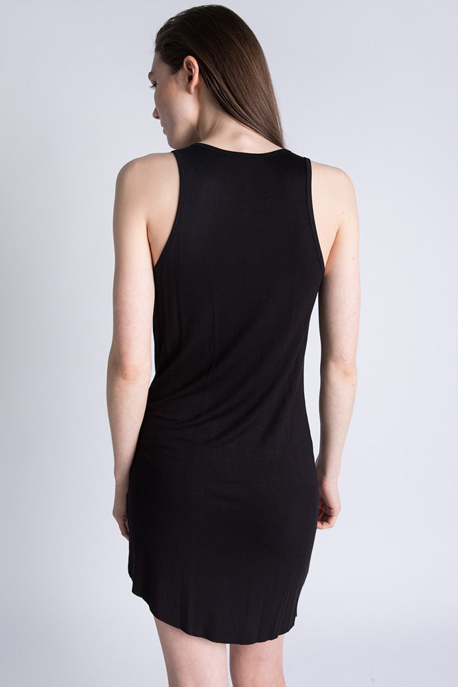 Back of Casa Como black long line racer back tank top with curbed hem.