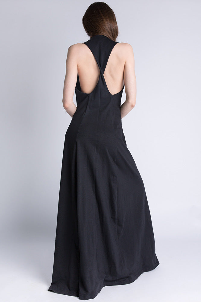 Back of Casa Como full length black dress with twisted open back.