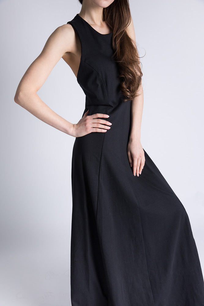 Side of Casa Como full length black dress with twisted open back.