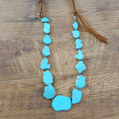 Step It Up Large Turquoise Necklace