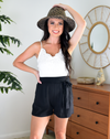 white lace romper with black shorts