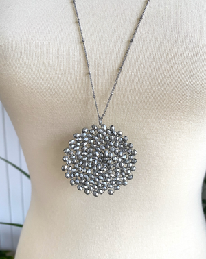 Twist & Turn Pendant Necklace