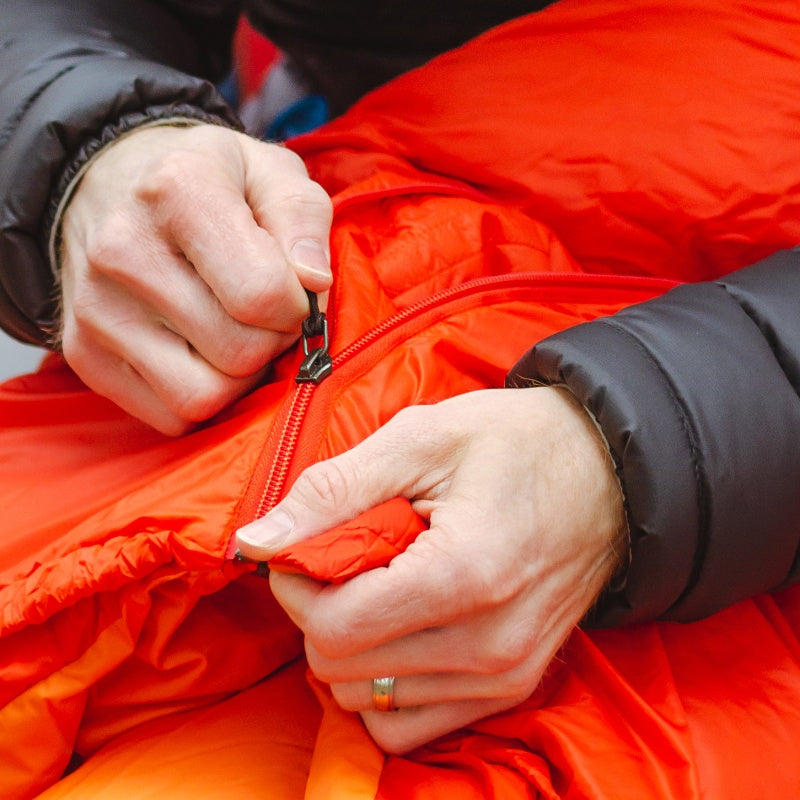 Zippers are perfect for someone looking for convenience in situations, such as car camping, where weight doesn't matter quite as much.