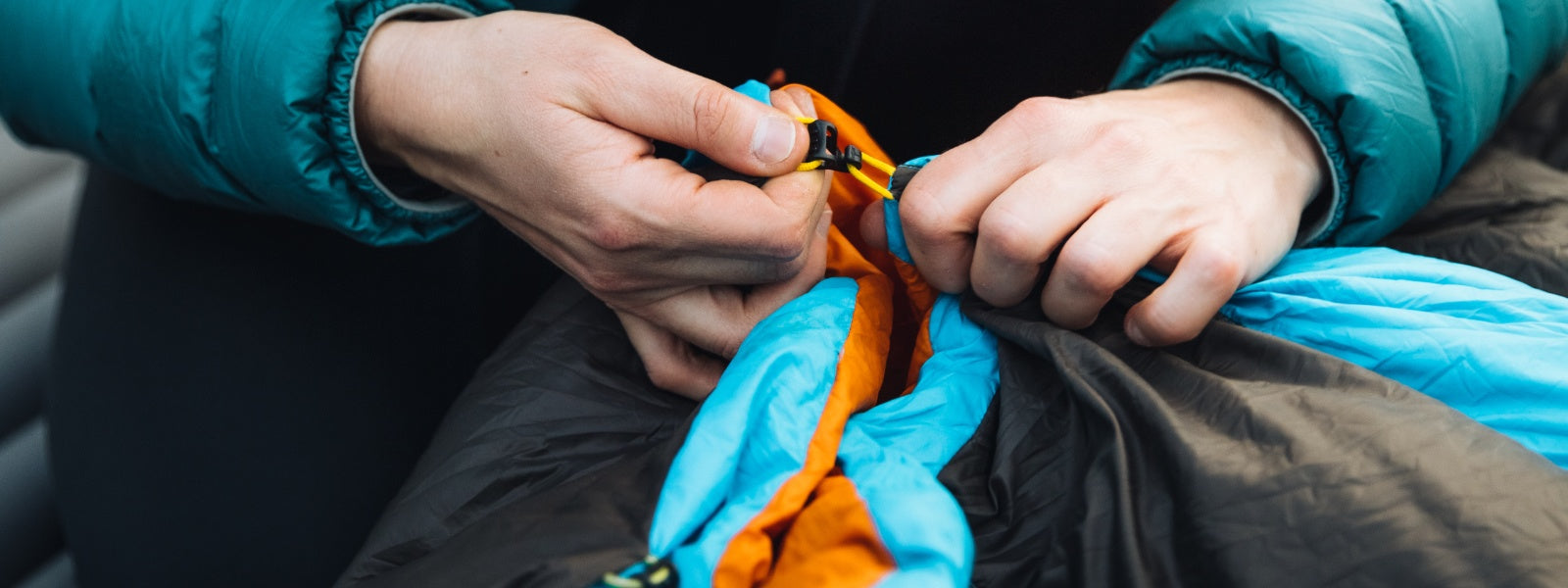 Hooks and loops are versatile and nearly weightless compared to the bulk and weight of zippers. They take a little more explaining, but once you get the hang of them, set up is a breeze!